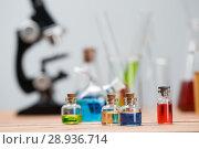 Купить «Test tubes on a table», фото № 28936714, снято 4 августа 2018 г. (c) Типляшина Евгения / Фотобанк Лори