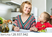 Купить «woman and her daughter working with papers from home», фото № 28937942, снято 14 августа 2018 г. (c) Яков Филимонов / Фотобанк Лори