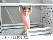 Купить «Cute 2 years little girl in her white bed at home», фото № 28938322, снято 20 июля 2018 г. (c) ivolodina / Фотобанк Лори