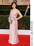 Maisie Williams (wearing a Charlie Brear gown) at arrivals for 23rd Annual Screen Actors Guild Awards, Presented by SAG AFTRA _ ARRIVALS 2, Shrine Exposition... Редакционное фото, фотограф Dee Cercone/Everett Collection / age Fotostock / Фотобанк Лори