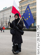 Купить «Opposition on an electric-powered unicycle with a Polish and EU flag on the brink of a demonstration against racism and xenophobia», фото № 28943754, снято 7 января 2016 г. (c) Caro Photoagency / Фотобанк Лори