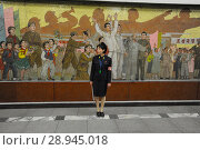 Купить «Pjoengjang, North Korea, a platform overseer on a subway station», фото № 28945018, снято 9 августа 2012 г. (c) Caro Photoagency / Фотобанк Лори