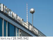 Купить «Detail of the Cafe Moskau with TV tower and a DDR-Plattenbau in the Karl-Marx-Allee», фото № 28945942, снято 29 мая 2017 г. (c) Caro Photoagency / Фотобанк Лори