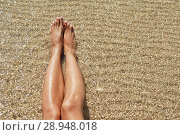 Купить «Female feet against the sea on the summer beach, time to travel. Empty place for a text», фото № 28948018, снято 4 августа 2018 г. (c) Happy Letters / Фотобанк Лори