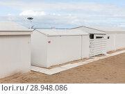 Купить «Ostende, Belgium, Holzhuetten on the beach in Ostend», фото № 28948086, снято 30 июля 2017 г. (c) Caro Photoagency / Фотобанк Лори