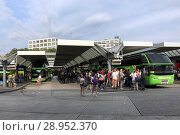 Купить «Berlin, Germany, people and coaches at the central bus station Berlin (ZOB)», фото № 28952370, снято 22 июля 2017 г. (c) Caro Photoagency / Фотобанк Лори