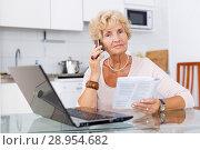 Купить «Woman making order on Internet», фото № 28954682, снято 11 июля 2018 г. (c) Яков Филимонов / Фотобанк Лори