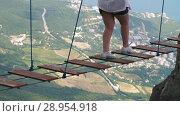 Купить «Woman walking by suspension bridge», видеоролик № 28954918, снято 9 августа 2018 г. (c) Илья Шаматура / Фотобанк Лори