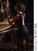 Купить «elegant lady in black dress, in restaurant at a bar», фото № 28957426, снято 19 июля 2018 г. (c) Restyler Viacheslav / Фотобанк Лори