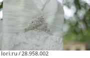 Купить «White wedding dress hanging on a tree near the castle», видеоролик № 28958002, снято 8 августа 2018 г. (c) Aleksejs Bergmanis / Фотобанк Лори