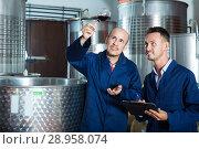 Купить «Workers taking notes wine sample», фото № 28958074, снято 16 августа 2018 г. (c) Яков Филимонов / Фотобанк Лори