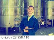 Купить «Portrait of man worker on wine factory», фото № 28958110, снято 16 августа 2018 г. (c) Яков Филимонов / Фотобанк Лори