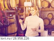 Купить «Portrait of female holding wine glass in winery», фото № 28958226, снято 20 августа 2018 г. (c) Яков Филимонов / Фотобанк Лори