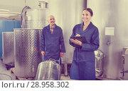 Купить «Woman and standing man in fermentation section», фото № 28958302, снято 16 августа 2018 г. (c) Яков Филимонов / Фотобанк Лори