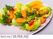 Купить «Tasty salad of baked pumpkin, cherry tomatoes, sesame and sauce», фото № 28958342, снято 21 августа 2018 г. (c) Яков Филимонов / Фотобанк Лори