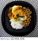Купить «Chicken thighs with cabbage leaves in batter, cheakpea and rice at plate», фото № 28958394, снято 17 августа 2018 г. (c) Яков Филимонов / Фотобанк Лори