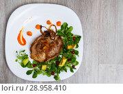 Купить «Top view of fried pork chop with pumpkin puree, avocado, cornsalad», фото № 28958410, снято 16 августа 2018 г. (c) Яков Филимонов / Фотобанк Лори