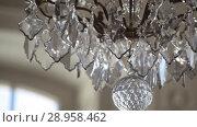 Купить «A Vintage Chandelier on white ceiling in old castle», видеоролик № 28958462, снято 8 августа 2018 г. (c) Aleksejs Bergmanis / Фотобанк Лори
