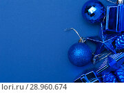 Купить «Blue Christmas decoration toys on blue background», фото № 28960674, снято 5 января 2018 г. (c) Pavel Biryukov / Фотобанк Лори
