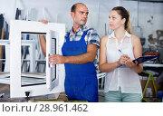 Купить «Female supervisor checking quality of finished PVC windows with workman», фото № 28961462, снято 19 июля 2017 г. (c) Яков Филимонов / Фотобанк Лори