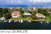 Long Boat Key is next to Sarasota and Anna Maria Island Florida and is an expensive upscale neighborhood and favorite vacation holiday destination on the Gulf of Mexico on Florida's gold coast. Стоковое фото, фотограф Dennis MacDonald / age Fotostock / Фотобанк Лори