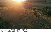 Купить «Couple hiking on sunset», видеоролик № 28974722, снято 20 июля 2018 г. (c) Илья Шаматура / Фотобанк Лори