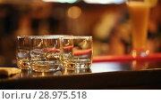 Купить «The bartender put the finished cocktail on the bar, four glasses are on the bar», видеоролик № 28975518, снято 4 апреля 2020 г. (c) Константин Шишкин / Фотобанк Лори