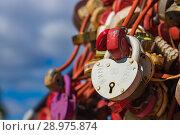 "Купить «Tradition of hanging locks on a bridge. A wedding castle with the inscription ""you and I forever"". City of Cheboksary, Russia, 08/18/2018», фото № 28975874, снято 18 августа 2018 г. (c) Александр Якимов / Фотобанк Лори"