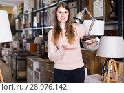 Купить «Woman choosing lamp in store», фото № 28976142, снято 15 ноября 2017 г. (c) Яков Филимонов / Фотобанк Лори