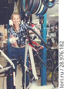 Купить «worker is standing near bicycle and cheking wheels», фото № 28976182, снято 13 сентября 2017 г. (c) Яков Филимонов / Фотобанк Лори