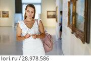 Купить «Woman visiting painting exhibition», фото № 28978586, снято 28 июля 2018 г. (c) Яков Филимонов / Фотобанк Лори