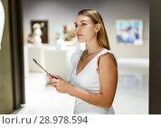 Купить «Woman observing museum exposition», фото № 28978594, снято 28 июля 2018 г. (c) Яков Филимонов / Фотобанк Лори