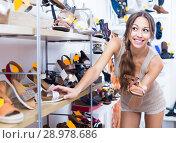 Купить «Woman choosing pair of summer shoes», фото № 28978686, снято 21 сентября 2018 г. (c) Яков Филимонов / Фотобанк Лори