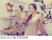 Купить «Woman holding desired shoe», фото № 28978694, снято 20 сентября 2018 г. (c) Яков Филимонов / Фотобанк Лори