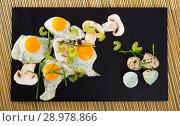 Купить «Fried quail eggs with champignons», фото № 28978866, снято 17 декабря 2018 г. (c) Яков Филимонов / Фотобанк Лори