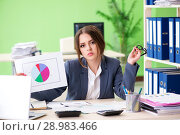 Купить «Female financial manager presenting graph chart sitting in the o», фото № 28983466, снято 8 июня 2018 г. (c) Elnur / Фотобанк Лори