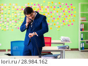 Купить «The businessman with many conflicting priorities», фото № 28984162, снято 23 мая 2018 г. (c) Elnur / Фотобанк Лори