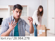Купить «The woman evicting man from house during family conflict», фото № 28984278, снято 23 марта 2018 г. (c) Elnur / Фотобанк Лори