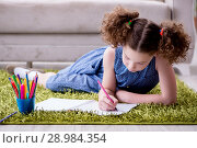 Купить «The young little girl drawing on paper with pencils», фото № 28984354, снято 24 июня 2017 г. (c) Elnur / Фотобанк Лори