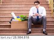 Купить «The young businessman on the street after dismissal», фото № 28984818, снято 30 марта 2017 г. (c) Elnur / Фотобанк Лори
