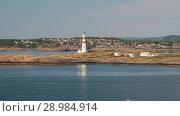 Морское побережье и маяк. Кристиансанн. Норвегия (2018 год). Стоковое видео, видеограф Вадим Хомяков / Фотобанк Лори