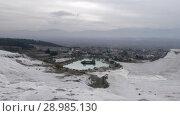 Купить «Pamukkale travertine terraces and town view, Turkey», видеоролик № 28985130, снято 21 января 2019 г. (c) Данил Руденко / Фотобанк Лори
