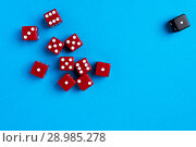 Купить «Red and black gaming dices on blue background», фото № 28985278, снято 3 января 2018 г. (c) Pavel Biryukov / Фотобанк Лори