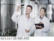Man and woman employees on winery manufactory. Стоковое фото, фотограф Яков Филимонов / Фотобанк Лори