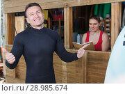 Купить «man satisfied with a rented equipment for surfing», фото № 28985674, снято 30 апреля 2018 г. (c) Яков Филимонов / Фотобанк Лори