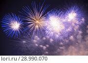 Купить «Celebratory colorful fireworks exploding in the skies.», фото № 28990070, снято 24 августа 2018 г. (c) Владимир Журавлев / Фотобанк Лори