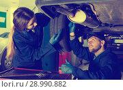 Two masters are repairing car on their workplace. Стоковое фото, фотограф Яков Филимонов / Фотобанк Лори