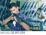 Купить «Man choice pneumatic gun», фото № 28991034, снято 4 июля 2017 г. (c) Яков Филимонов / Фотобанк Лори
