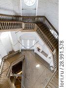 Купить «Wooden spiral staircase in the ancient bell tower of the Orthodox Church», фото № 28991578, снято 19 января 2019 г. (c) Mikhail Starodubov / Фотобанк Лори