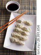 Купить «Chinese dumplings with soy sauce», фото № 28991654, снято 31 июля 2018 г. (c) Stockphoto / Фотобанк Лори